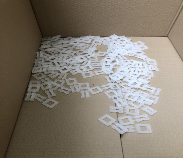 Plastic clips for pallet strapping tool